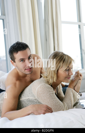 Young romantic couple rela in bed    Stock Image. Man Mid Adult Couple Bedroom Barechest Bed Stock Photos   Man Mid