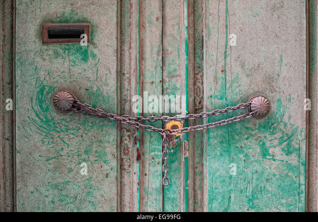 An old traditional door locked with chain and padlock. - Stock Image & Lock Chain Door Chained Stock Photos \u0026 Lock Chain Door Chained ... Pezcame.Com