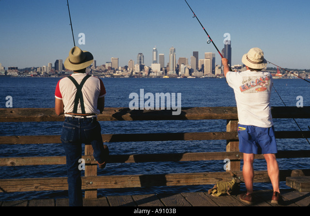 People fishing on public dock stock photos people for Seattle fishing pier