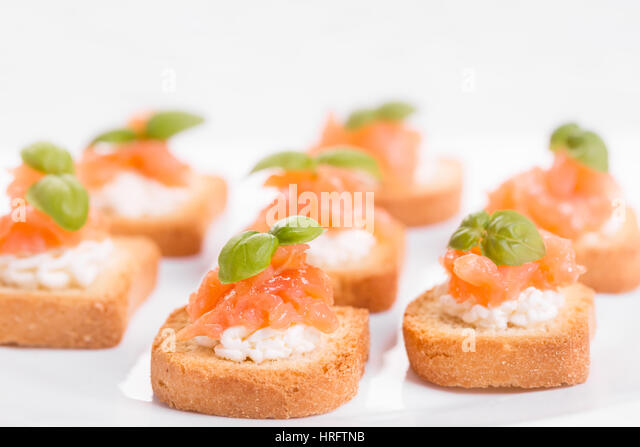 Canapes white background stock photos canapes white for Smoked salmon cream cheese canape
