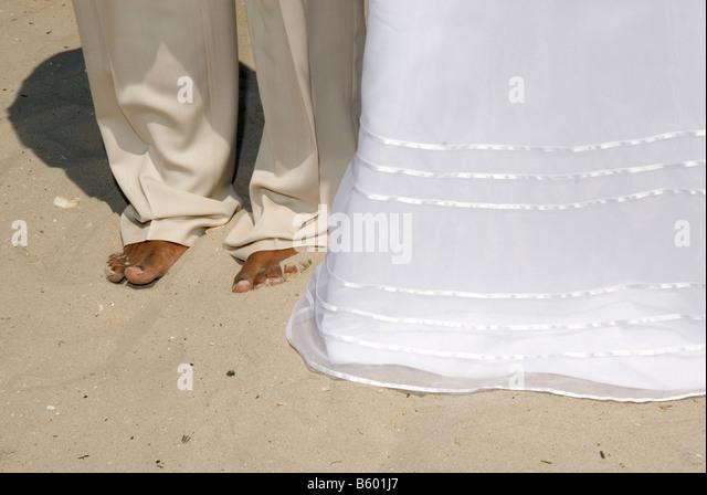 Bare Feet At A Beach Wedding