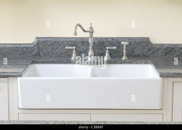 Double French farmhouse sink with the ceramic front exposed and set ...