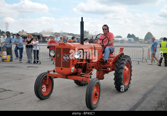 Tractor Going Right On Man : Vintage tractor man stock photos