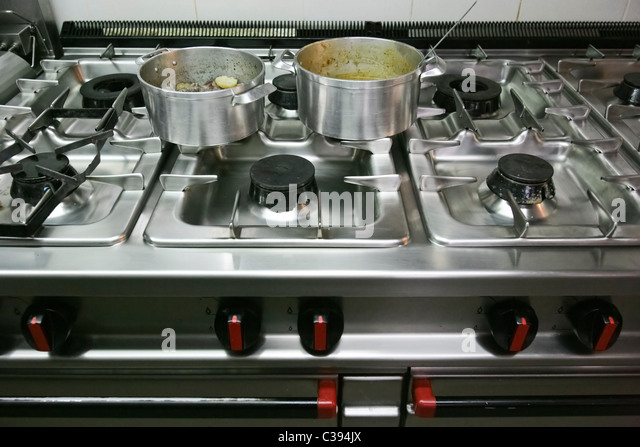 Restaurant Kitchen Gas Stove professional kitchen gas cooker hob stock photos & professional