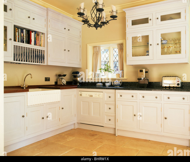 Cream Ed Units And Cupboards In Country Kitchen With White Stock Image