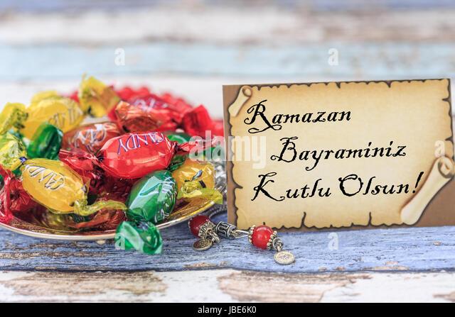 Amazing Turkey Eid Al-Fitr Feast - happy-eid-al-fitr-in-turkish-on-the-card-with-candies-on-vintage-table-jbe6k0  Image_653077 .jpg