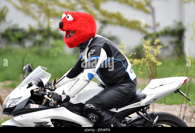 A Motorcyclist Wearing Helmet With Elmo