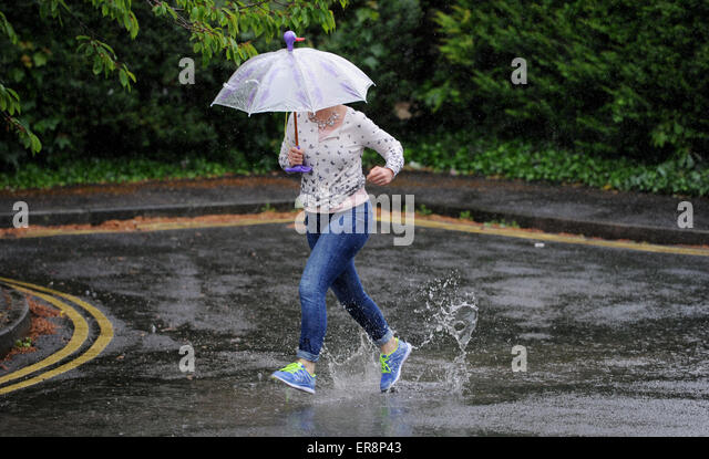 Caught In The Rain Stock Photos & Caught In The Rain Stock ...