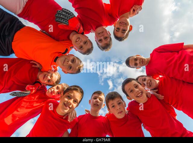 Soccer team huddle kids