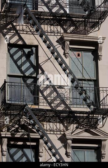 Apartment Building Fire Escape Ladder fire escape ladders stock photos & fire escape ladders stock