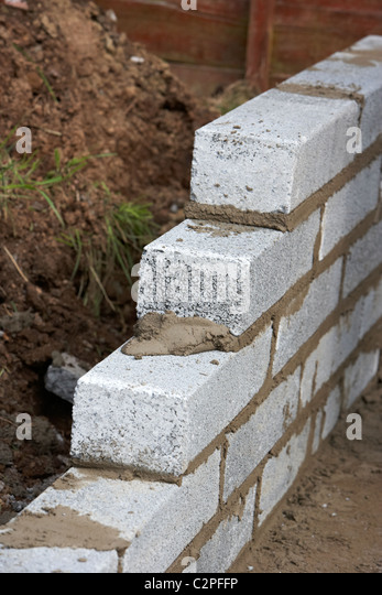 Bricklaying Wall With Half Cement Breeze Blocks Building A Block Retaining  Wall In The Uk
