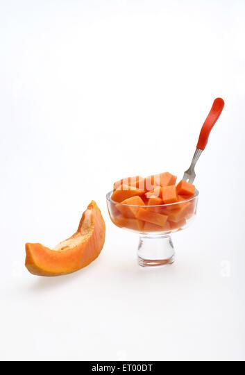 ... Papaya Latin Carica Papaya slice ; fruit salad with fork in glass bowl