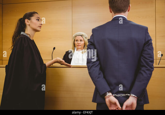 lawyer-talking-with-the-criminal-in-hand