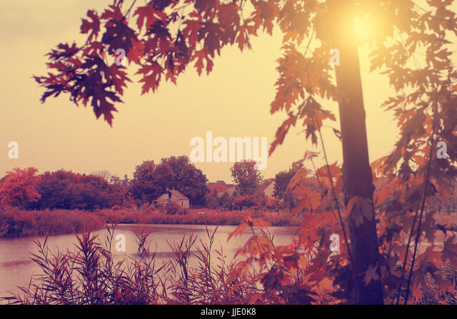 Vintage photo of autumn scene with lake - Stock Image