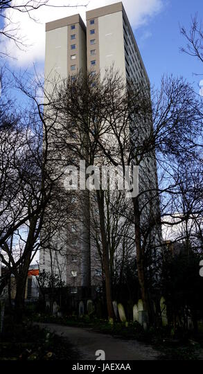 Tower Block Overlooking Cemetery - Stock Image