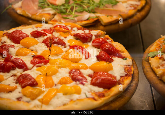 ... Italian pizza with red and yellow roasted peppers. - Stock Image