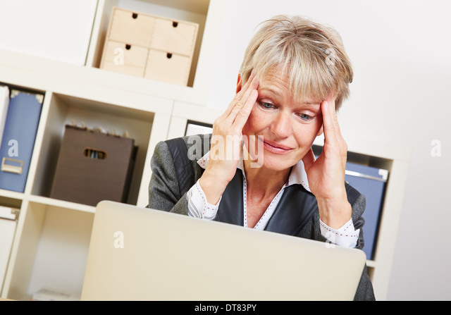 elderly business woman sitting with burnout in he office at the desk stock image business nap office relieve