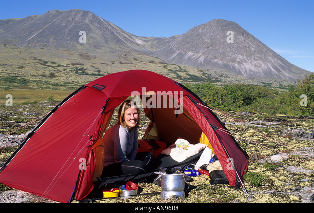 Happy woman sitting inside tent. Rondane Norway - Stock Image  sc 1 st  Alamy & Woman Cooking Food At The Tent Rondane Stock Photos u0026 Woman ...