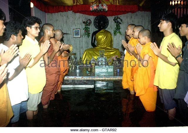 buddhist single men in deep water Here the buddha says that wise men,  the monks would come in a procession in single file in order of  buddhist ceremonies and rituals of sri lanka, by ags .