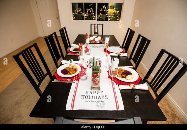 Table Set For Christmas Dinner table laid for christmas dinner stock photos & table laid for