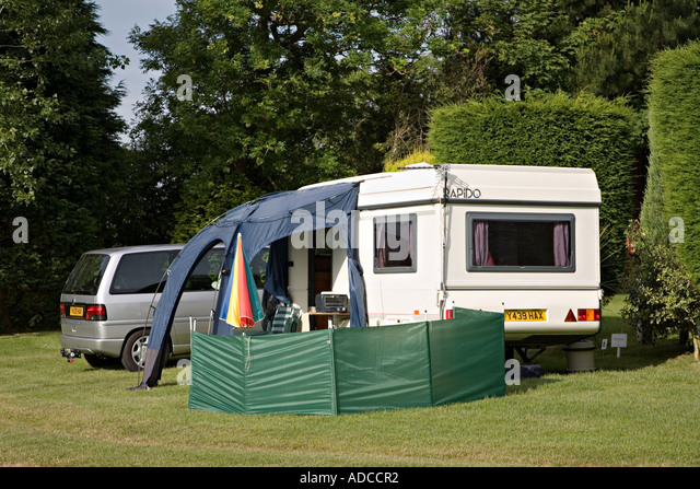 Caravan Pitched With Awning And Windbreak Car Parked Alongside On A Campsite Anglesey In