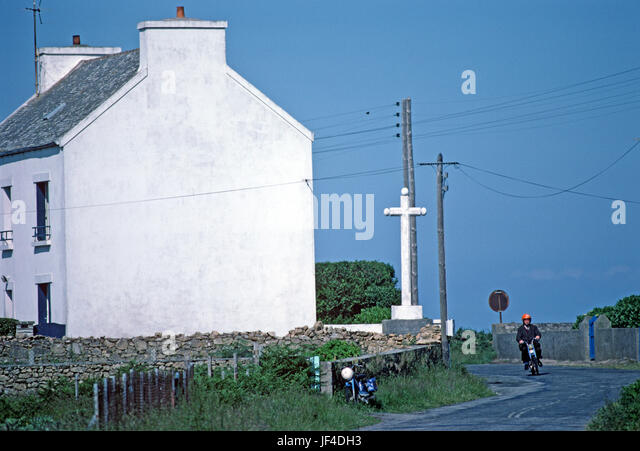 Man On Mobylette Roundin Corner On Island Of Ushant, Brittany, France    Stock Image