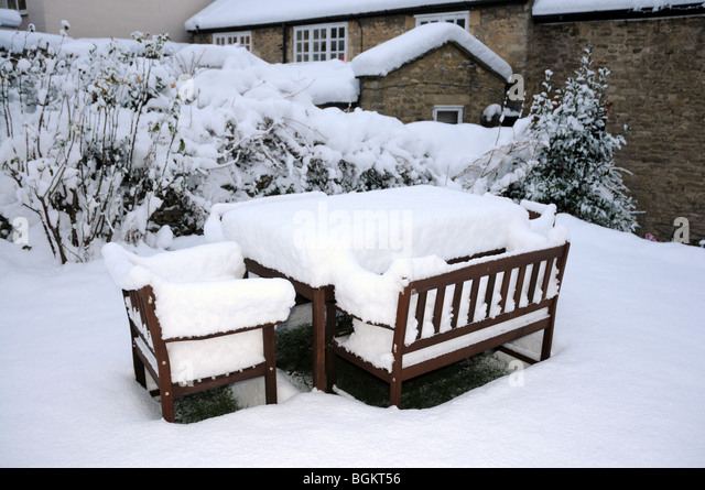 GArden furniture after a snowstorm in the cotswolds   Stock Image. Garden Furniture Bright Stock Photos   Garden Furniture Bright