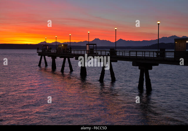 Olympic mountains at sunset stock photos olympic for Seattle fishing pier