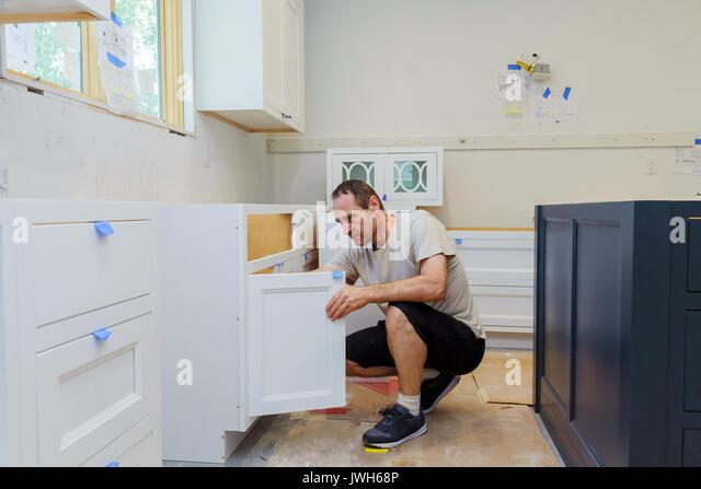 Unique Kitchen Cabinet Carpenter Cupboard Installation Of Installs Stock Image With Design Decorating