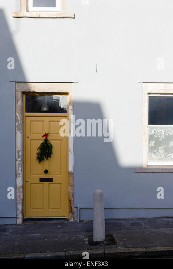 An old yellow front door with pattern of shadows and a wreath on a house in & Bristol Door Wreath Stock Photos u0026 Bristol Door Wreath Stock ... pezcame.com