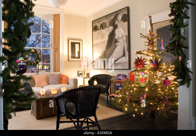 Christmas tree and decorations in the living room of a Georgian townhouse,  London - Stock - Christmas Tree Lights Lights Of A Christmas Tree Stock Photos