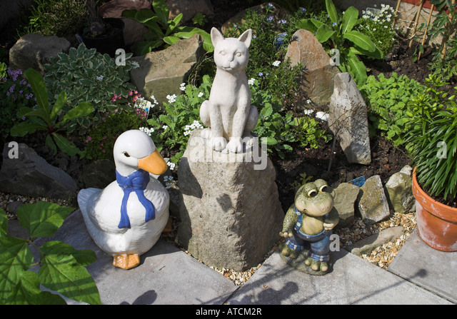 Garden Ornaments, Including Model Of A Duck, A Cat And A Frog.