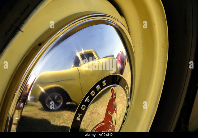 reflection of car in hub cap off old gmh holden car horizontal bapda8058 stock image