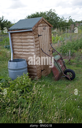 Collecting Rainwater From Shed Roof On Community Allotments Bishops Cleeve  Cheltenham UK   Stock Image