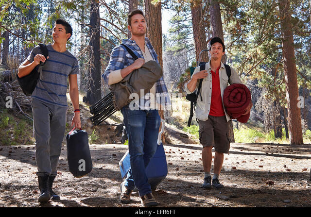 Three Young Men In Forest With Camping Equipment Los Angeles California USA