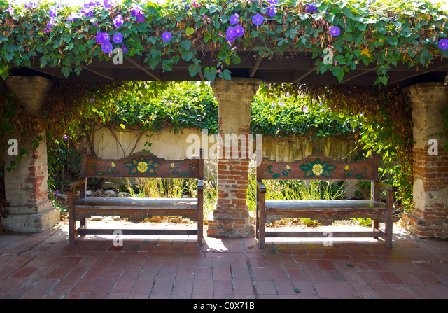 Two Seats In The Garden Of The Mission San Juan Capistrano, California    Stock Image