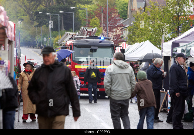 Fire Engine Making Its Way Through People At An Outdoor Event In The Rain  Northern Ireland