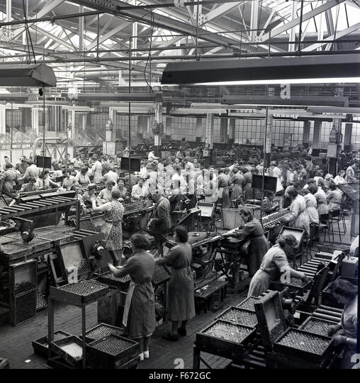 1950s Historical Female Workers On The Factory Floor Of Ever Ready Battery Company