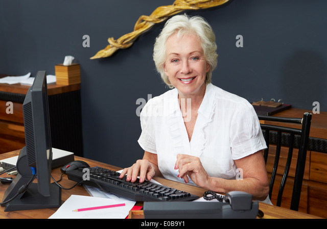 Hotel receptionist working computer stock photos hotel hotel receptionist working at computer stock image sciox Images