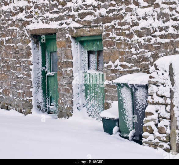 snow-blown-against-walls-and-doors-bh8gr