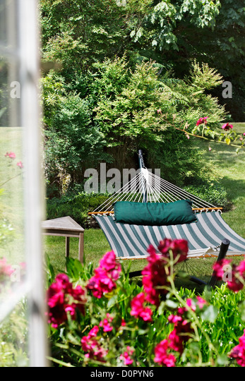 View Through A Window To A Garden Hammock   Stock Image