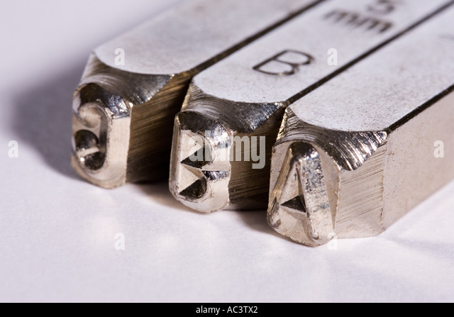 Indentify stock photos indentify stock images alamy for Punch letters into metal