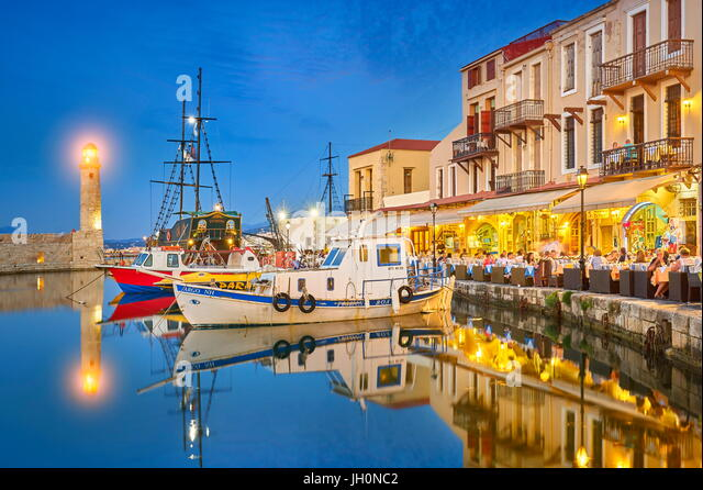 Evening at Old Venetian Port, lighthouse in the background, Rethymno, Crete Island, Greece - Stock Image