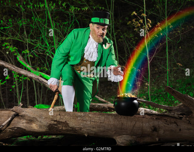 http://l7.alamy.com/zooms/20b5729549314104a2f80735064f803b/leprechaun-and-a-pot-of-gold-with-rainbow-coming-out-of-it-in-a-forest-g2mtrd.jpg