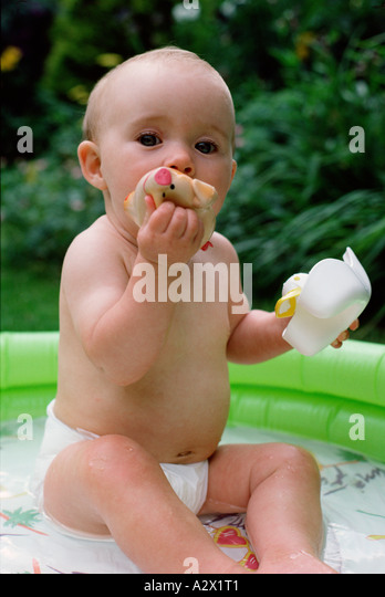 Baby paddling pool stock photos baby paddling pool stock for Baby garden pool