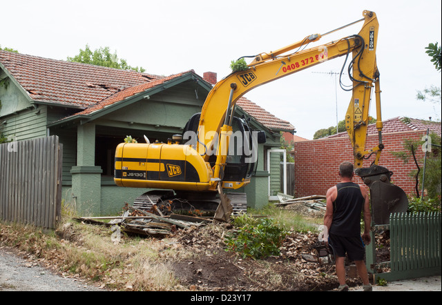 A Contractor Prepares To Begin Demolition Of 1920s Californian Bungalow Timber Home In
