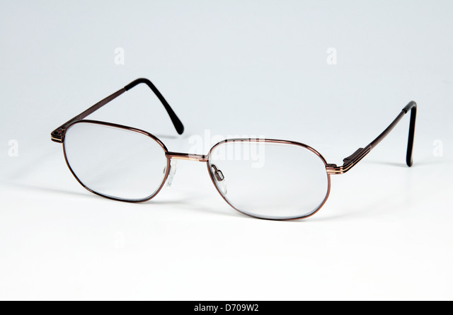 gents glasses against a plain background stock image - Wire Framed Glasses