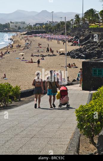Lanzarote beach family stock photos lanzarote beach - Lanzarote walks from puerto del carmen ...