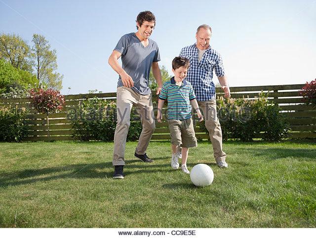 children playing football stock photos children playing football