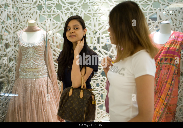 Two teenage girls look at dresses in an exclusive designer shop in the DLF  Emporio Mall. Teenage Girl New Delhi Stock Photos   Teenage Girl New Delhi Stock